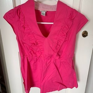 pink sleeveless blouse with ruffles